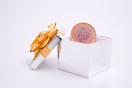 profit celebration: box to gift and coin on the white background