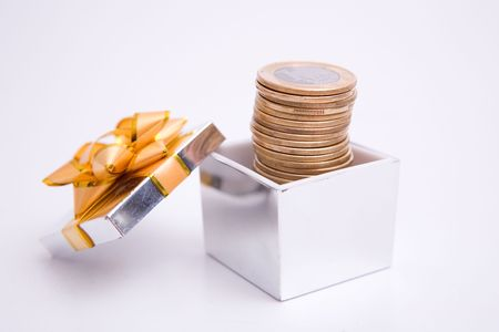 box to gift and coin on the white background photo