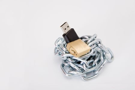 pendrive, chain and lock on the white background Stock Photo - 3727815
