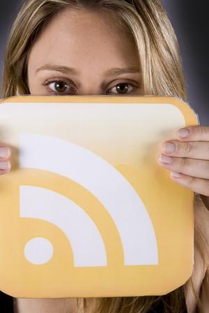 beautiful blond woman holding a rss logo Stock Photo - 4303845