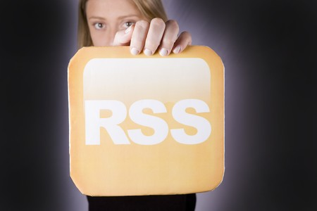 beautiful blond woman holding a rss logo Stock Photo - 4303828