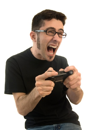 A young adult male on an isolated white background getting pretty excited and upset about his video games. photo