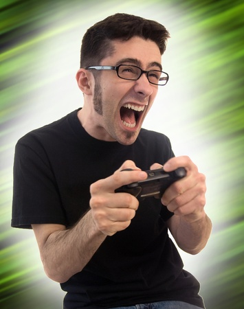 A young adult male on a funky green background getting pretty excited and upset about his video games.