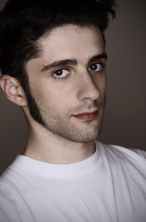 A handsome young mans portrait on gray Stock Photo - 8598159