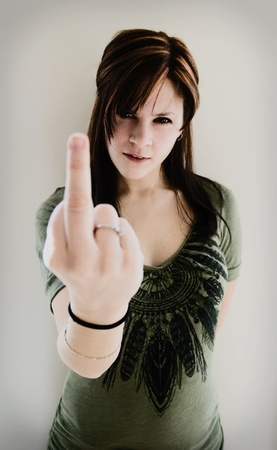 An angry woman with her middle finger up Stock Photo - 8598034