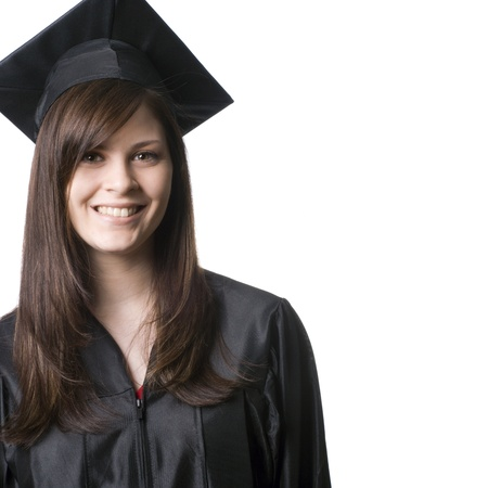 A happy, smiling, young woman in graduation cap and gown.