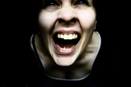 Weird creepy woman with mouth open on black background