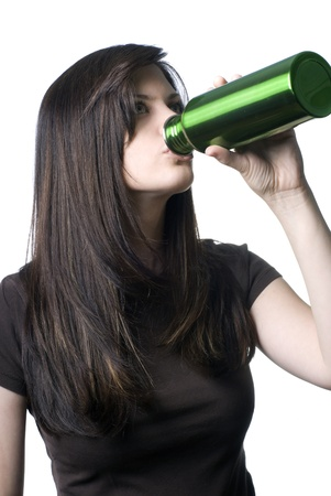 reusable: A young woman drinking out of a reusable water bottle. Archivio Fotografico