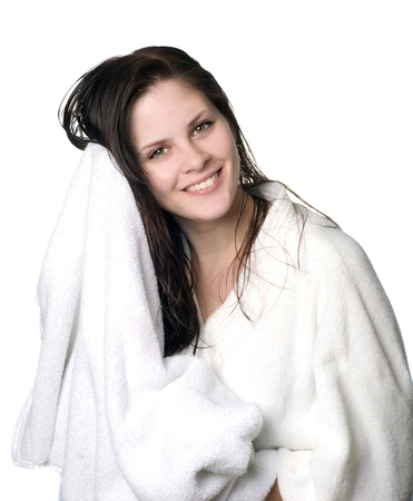 robe: A young woman with wet hair in white robe toweling off after a shower.