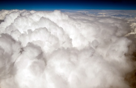 Fluffy clouds photographed from an airplane in flight.