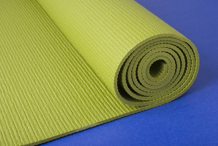A green yogapilatesexercise mat on a blue background activity, blue, exercise, floor, green, health, mat, object, peace, pilates, practice, sport, yoga