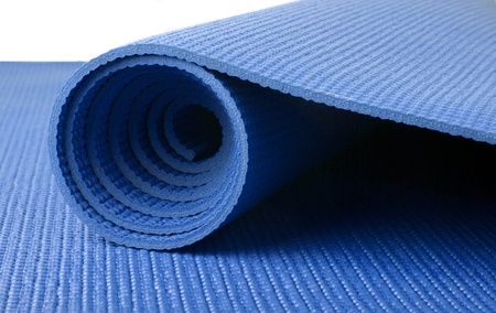 Blue yoga mat on white