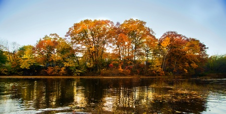 A beautiful autumn landscape with water and colorful trees. Stock Photo - 8774306