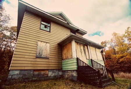 A boarded up, broken down, abandoned, haunted house  Stock Photo