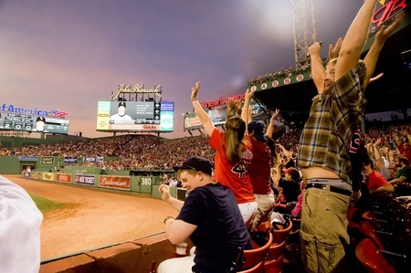 Boston - May 30: Fans do the wave at historic Fenway Park during Memorial Day game against the Chicago White Sox May 30, 2011 in Boston, Massachusetts. Editorial