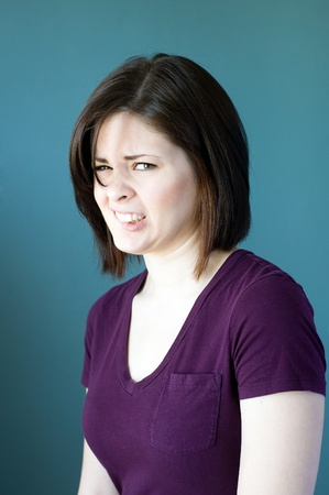 Young woman with an awkward expression on her face. Stock Photo - 9755826