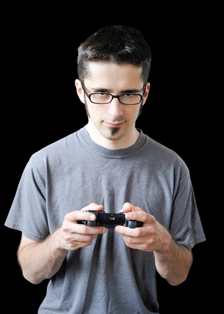 Young man playing video games holding a controller. photo