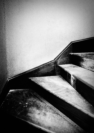 dingy: A dirty old staircase in grungy style in black and white Stock Photo