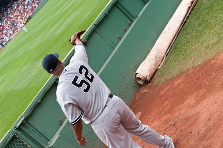 yankees: Boston - August 8: New York Yankees starting pitcher, #52, C.C. Sabathia warms up in the visiting bullpen before the game on August 8, 2011 at Fenway Park in Boston, Massachusetts. Editorial