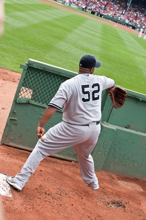Boston - August 8: New York Yankees starting pitcher, #52, C.C. Sabathia warms up in the visiting bullpen before the game on August 8, 2011 at Fenway Park in Boston, Massachusetts. Editöryel