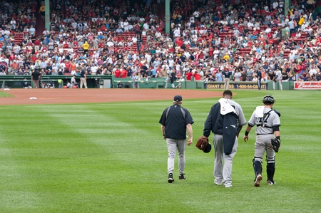 cc: Boston - August 8: New York Yankees starting pitcher, #52, C.C. Sabathia and catcher, #17, Francisco Cervelli make their way to the mound with pitching coach on August 8, 2011 at Fenway Park in Boston, Massachusetts.
