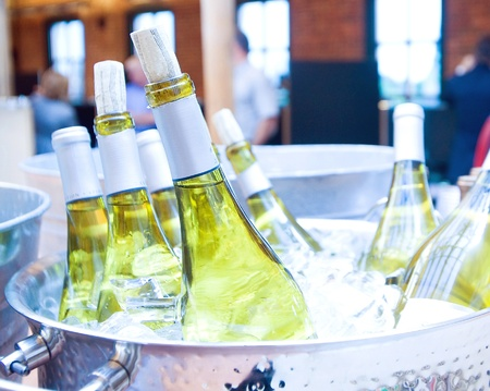 Bottles of white wine on ice at a party. Sajtókép