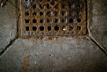 A dark, rusty, dirty, drain texture image with copy space. Stock Photo