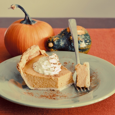 baked goods: A piece of pumpkin pie on a green plate. Stock Photo
