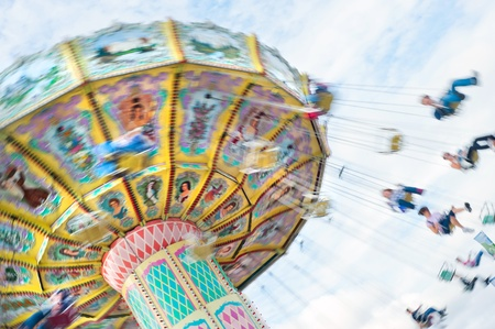 county: Swinging ride at a carnival with motion blur. Stock Photo