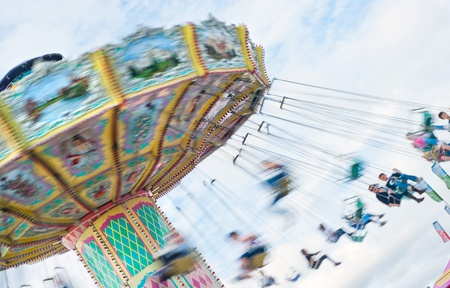 Swinging ride at a carnival with motion blur. Stok Fotoğraf