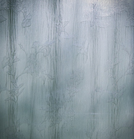 Curtain Drape texture in flowing cool blue tones  Stock Photo