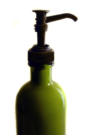 An isolated lotion bottle with green lotion  Reklamní fotografie