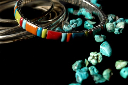 Bracelets and jewelry with turquoise on a black background  Stock Photo