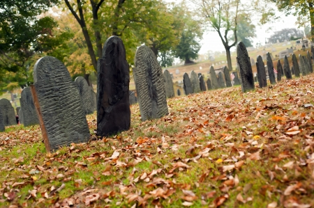 unmarked: Old unmarked gravestones in an old cemetery during autumn.