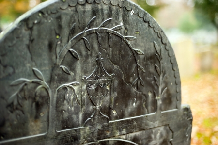 Detail of a gravestone in a cemetery during autumn photo
