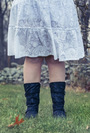 combat boots: Waist down image of a country girl in white paisley dress and combat boots. Stock Photo