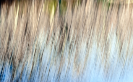 Abstract blurred movement of blue, brown, and green. Stock Photo