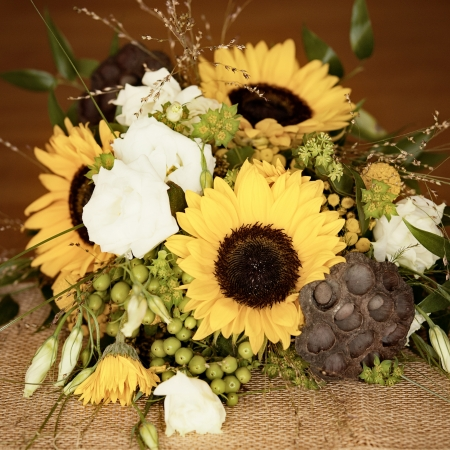 A pretty yellow and green wedding bouquet in a vintage style