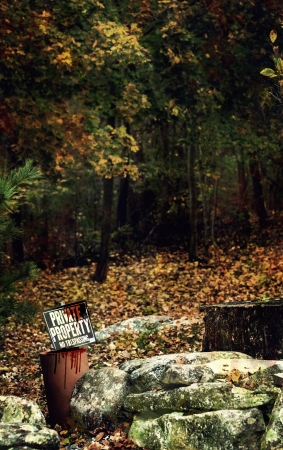 Private property sign with blood drips in autumn. photo
