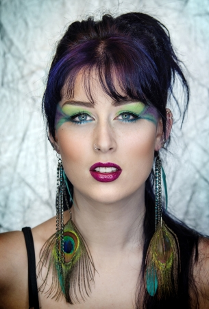 Beautiful young woman in peacock inspired makeup. photo