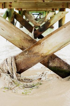 Wooden slats under an ocean pier
