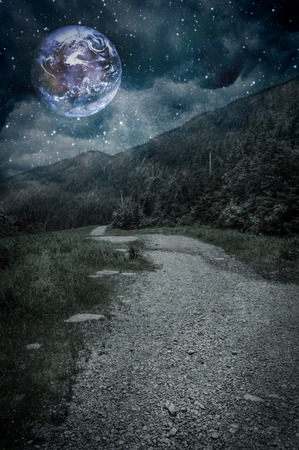 strange mountain: Mountain path with planet in night sky Stock Photo