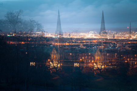 Panoramic picture of Glasgow at night. Blue sky and lights.