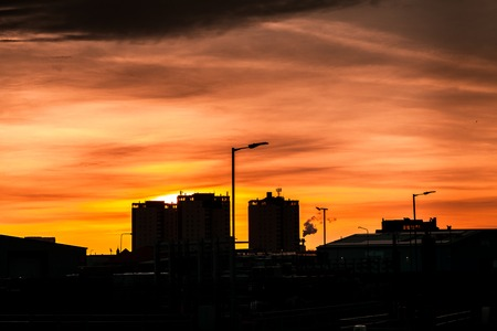 Silouhette of Glasgow High rise flats at sunset in Parkhead Stock Photo