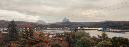 A panoramic image of Lochinver in the Sutherlands of Scotland. Part of the North Coast 500 Route. Stock Photo