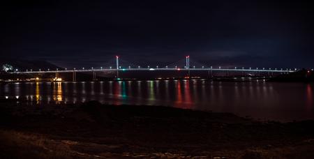 The Kessock Bridge in Inverness at night in Scotland Stock Photo