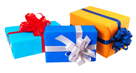 birth day: Three gift boxes wrapped in colorful paper, ribbon, bow ,Isolated on white. for anniversary, new year, birth day Stock Photo