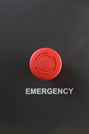 interrupt: Front view of red plastic emergency stop button on on metallic color background Stock Photo