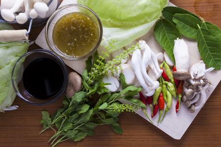 Ingredients for Thai food. chili, mushroom, sauce hairy basil, lemon leaf, soy sauce