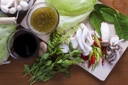 Ingredients for Thai food. chili, mushroom, sauce hairy basil, lemon leaf, soy sauce